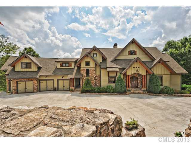 This three level custom lake estate is located in Statesville and priced at $1,750,000. The home features a media room, home office and gourmet kitchen.