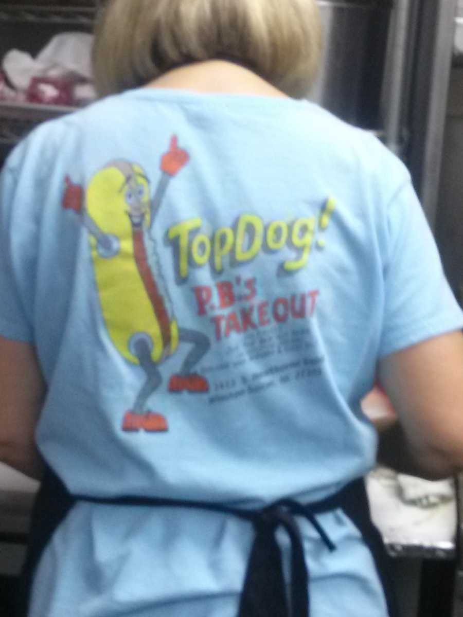Patty proudly wears her shirt as they get the lunch crowd fed. They even sell the shirts, what a crazy looking hot dog!