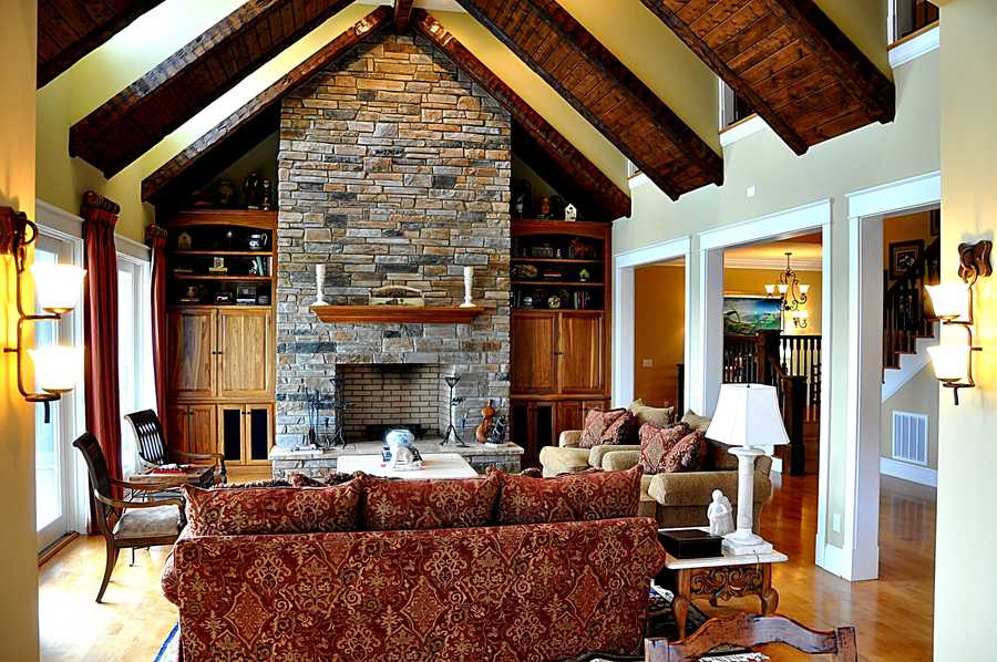 Great Room with cathedral ceiling and a floor to ceiling stone fireplace