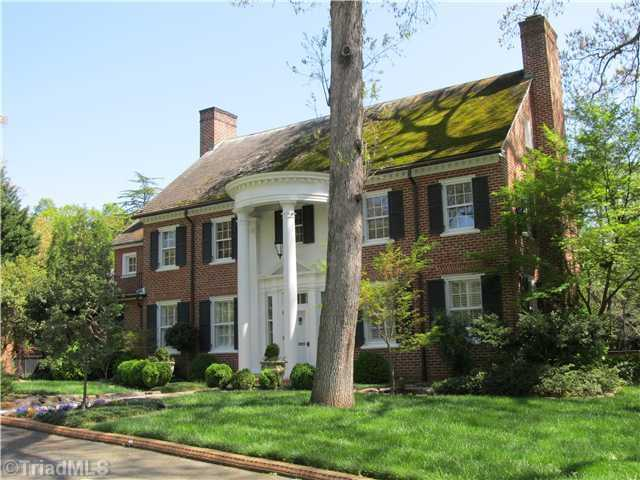 This Buena Vista home is located in Winston-Salem and priced at $1,175,000. This stately Georgian home features a sunroom with an antique tin tile ceiling, a mahogany library and a private guest suite.