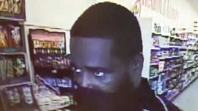 Family Dollar armed robbery surveillance image
