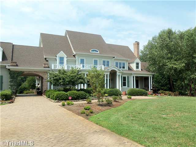This four bedroom, six bathroom estate is located in Winston-Salem and situated on 12 private acres. The home has three covered porches and two patios and is priced at $1,000,000.