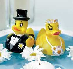 These cute ducks can be used as cake toppers, decorations like in this floating water arrangement or as seating name cards for the wedding guests.