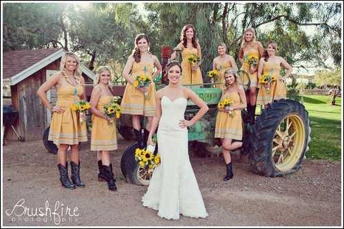 "These bridesmaids dresses and sunflowers look nice and with the brides dress is more traditional dress for a ""Country Themed Wedding"" as well."