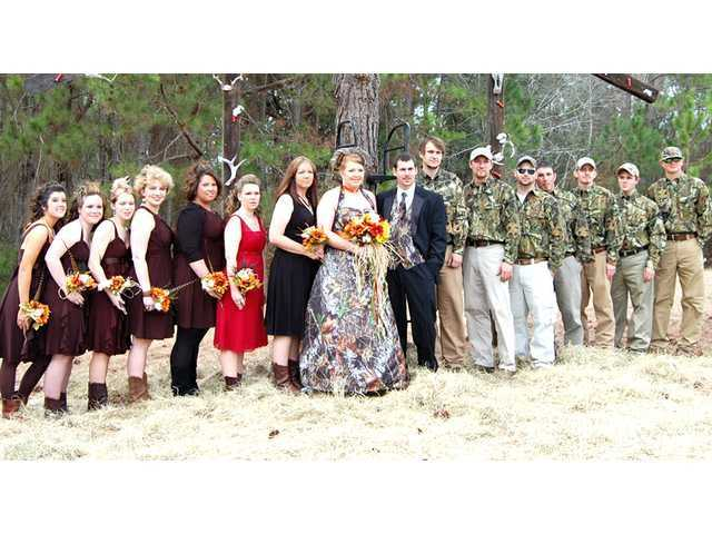 This group shot shows the bridesmaids dresses and boots plus the camouflage shirts the groomsmen wore. Check out how the groom's vest and tie match the brides dress.