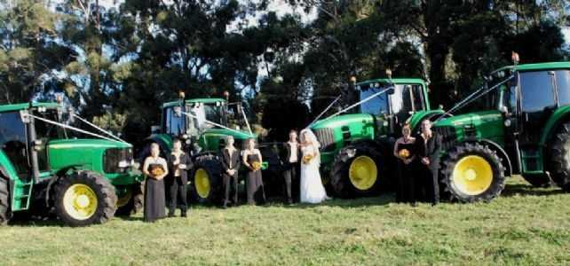 Don't forget those wedding party photos for memories after the wedding. What better background than John Deere tractors.