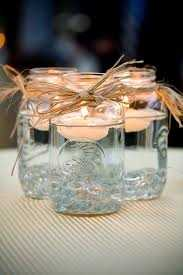 Mason jars can be used for so many decorations throughout the wedding and also for a Country Themed Wedding. These are used as floating candle holders.