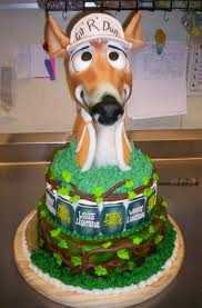 """Git-R- Dun!"" Wedding or groomsmen cake with a deer head and drinks around the bottom. Classic ""Redneck Wedding."""