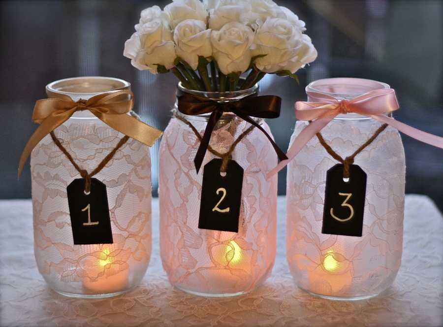 "These mason jars with lace are good for seating chart table numbers that are beautiful decorations for a more traditional ""Redneck or Country Wedding Theme."""