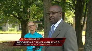 Superintendent Dr. Beverly Emory and Police Chief Barry Rountree talk to reporters.