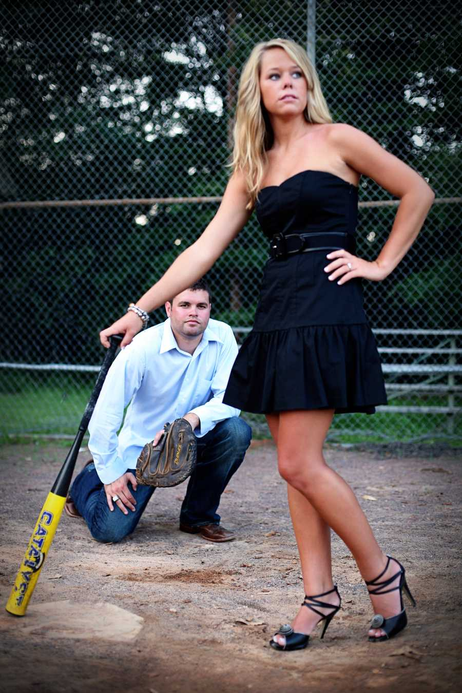 These baseball fans make a great pose for their engagement photo session. Great photo for their Save-The-Date cards.