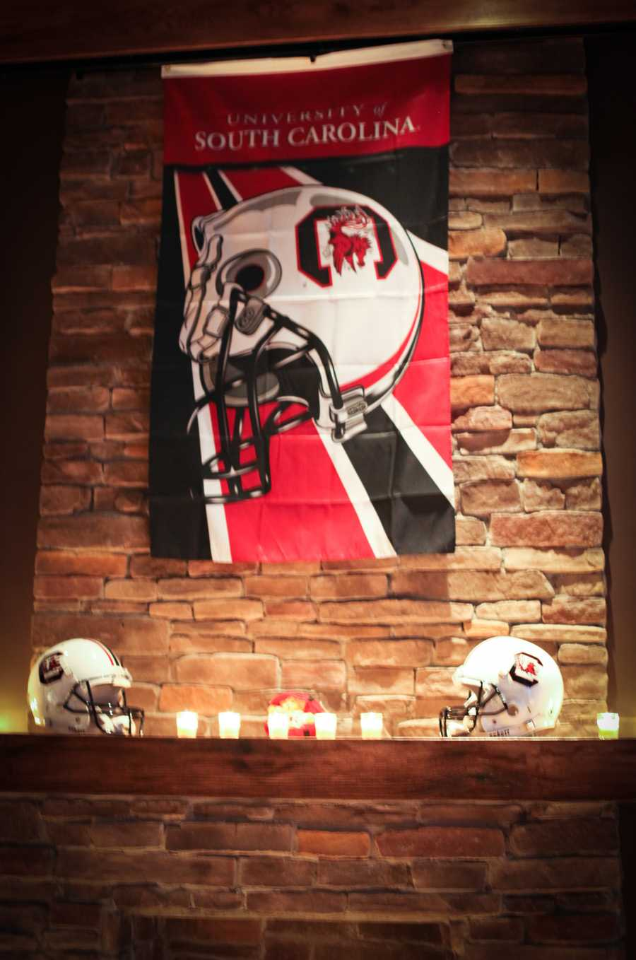 Even a flag is used for decoration on a wall to show the couples team spirit. The football helmets look great with the candle lighting too.