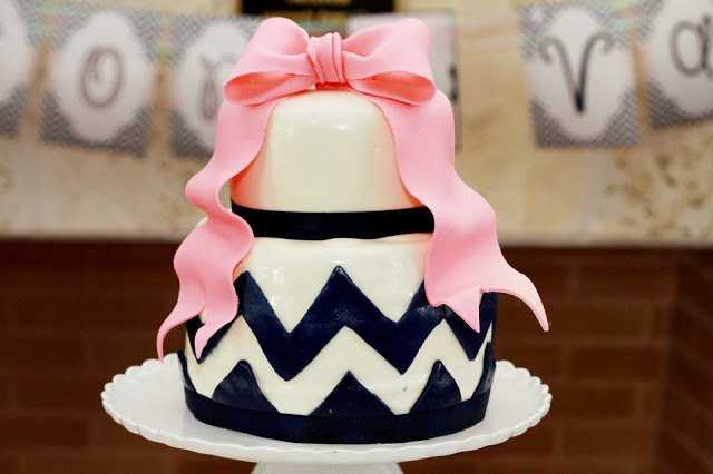 Look here to see this idea for a wedding cake with a bow.
