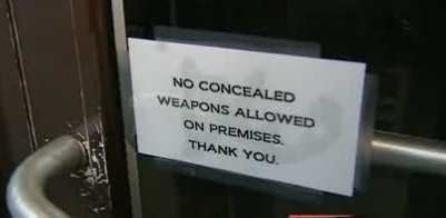 Under the law, it's up to individual restaurant owners to keep guns out of their businesses by posting signs.