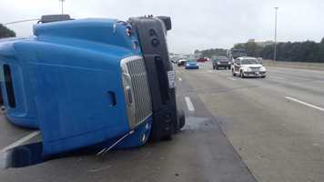 Photos by WXII's Bill O'Neil showed the tractor-trailer on its side. The tractor-trailer was carrying cigarettes.
