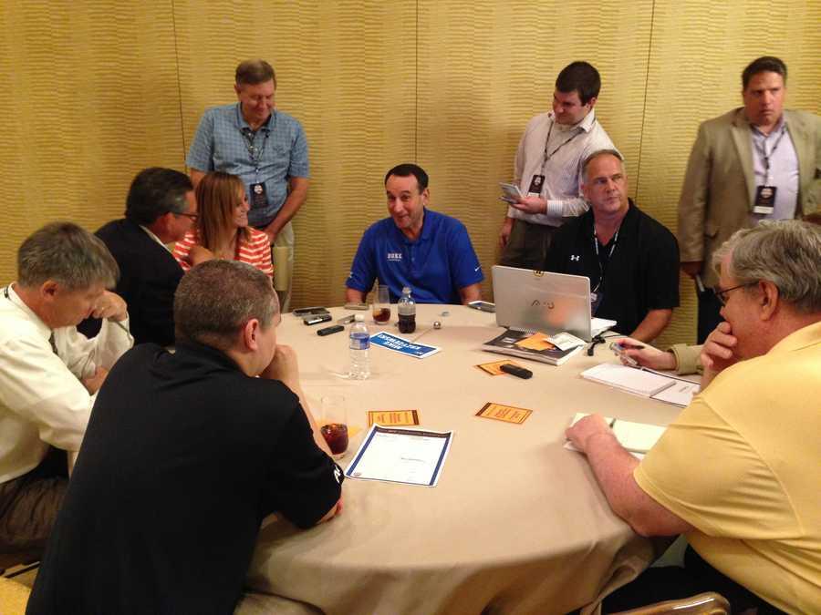 Duke coach Mike Krzyzewski talks to reporters.