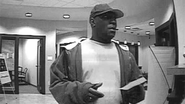 Surveillance image of suspect in First Community Bank robbery