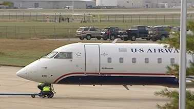A US Airways plane is readied for takeoff after making an emergency landing at PTI Airport early Wednesday morning.