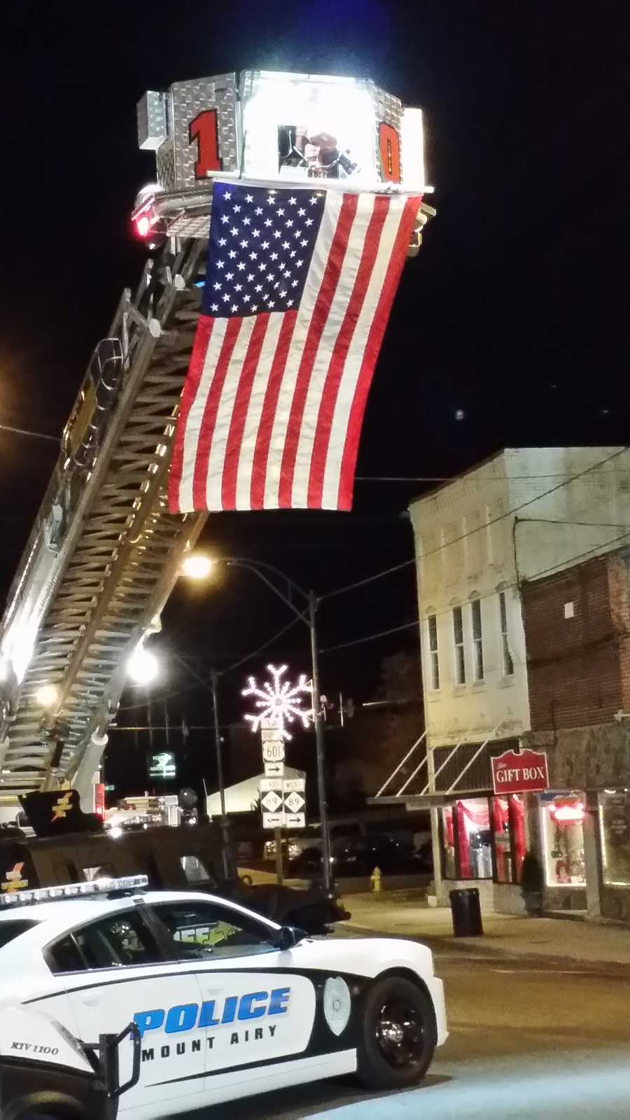 A big American flag is hoisted above downtown Mount Airy.