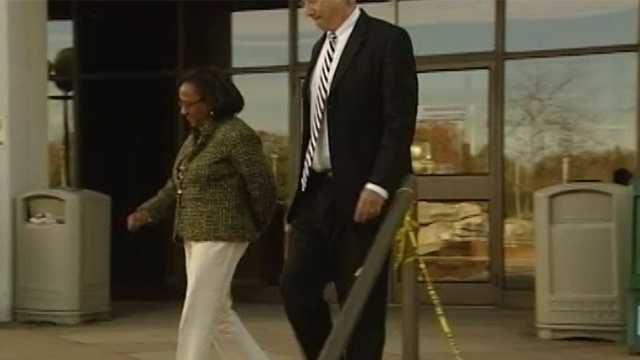 Mayor Bernita Sims turned herself in after being indicted by a grand jury on a felony charge.