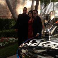 Nicole, Josh and Austin Dillon in front of the #3 Advocare car with the trophy