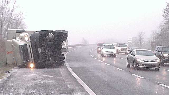 A truck flipped on its side on I-77 in Carroll County, leading to miles of delays on a popular Thanksgiving travel day.