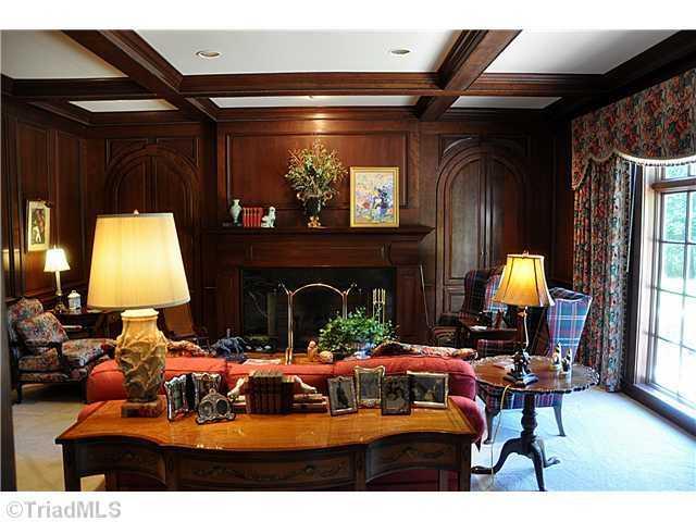 Beautiful wood work surrounds the fireplace