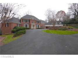 This five bedroom Winston-Salem estate is situated on over six acres. The home is priced at $1,845,000.