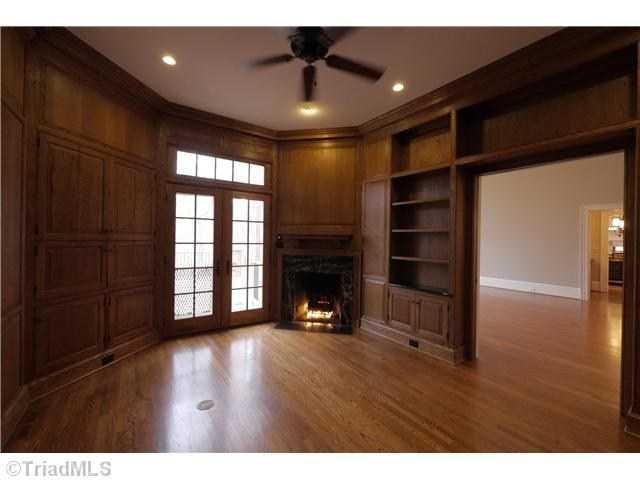 Walnut Paneled Library/ Study with Fireplace