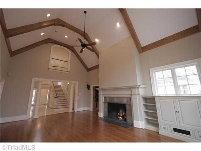 Great Room with a fireplace and vaulted ceiling
