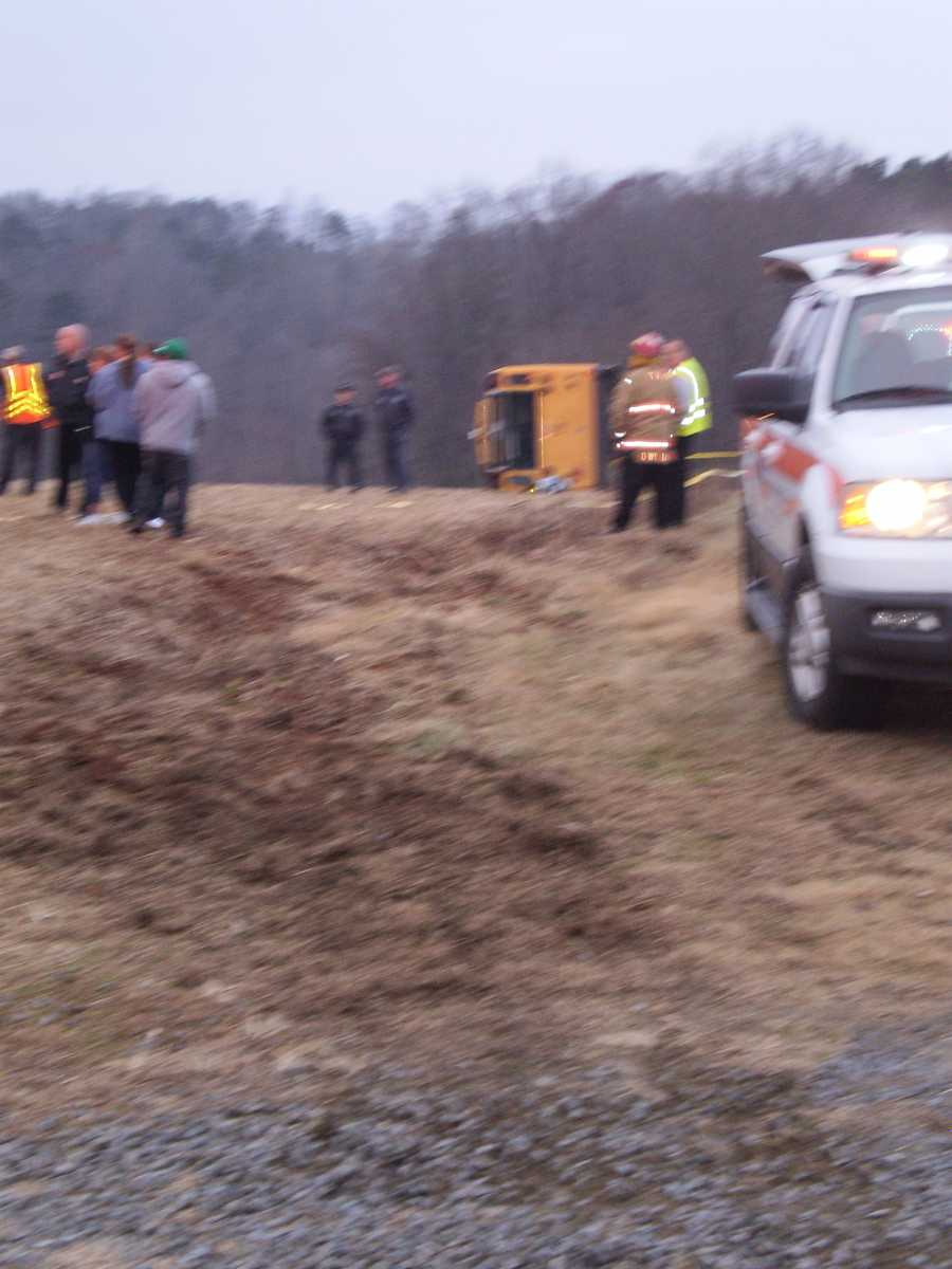 The bus landed on its side on an empty patch of land. It was towed from the scene about 90 minutes after the crash.