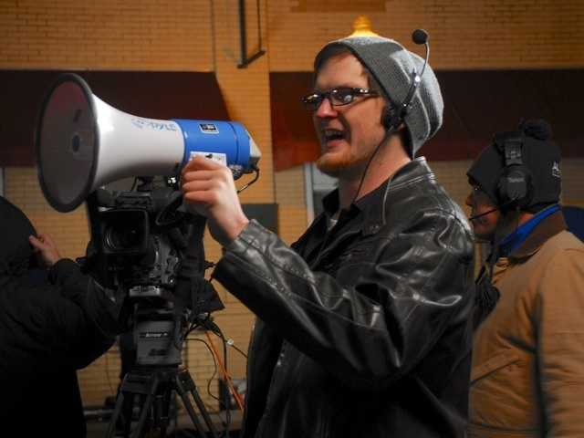 Production assistant Derek Gilreath helps call the shots in the field.