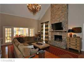 Great Room with floor to ceiling stone fireplace