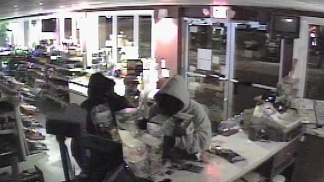 Surveillance image of lottery ticket theft suspects