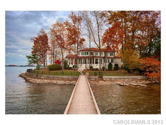 This four bedroom lakefront property is located in Denver, North Carolina and priced at $1,375,000. The home features a rec room with wet bar, a sun room and a veranda that provides beautiful views of Lake Norman.