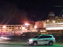 The Battalion Chief says the fire started at 1:45 a.m. at a catwalk that connects Plant 64 and the Wake Forest Research Building, which is under renovation.