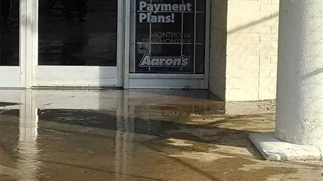 About 6 inches of standing water flooded the Aaron's store off Reynolda Road Friday.