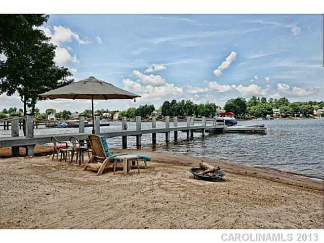 Private Beach includes a pier with a boat dock