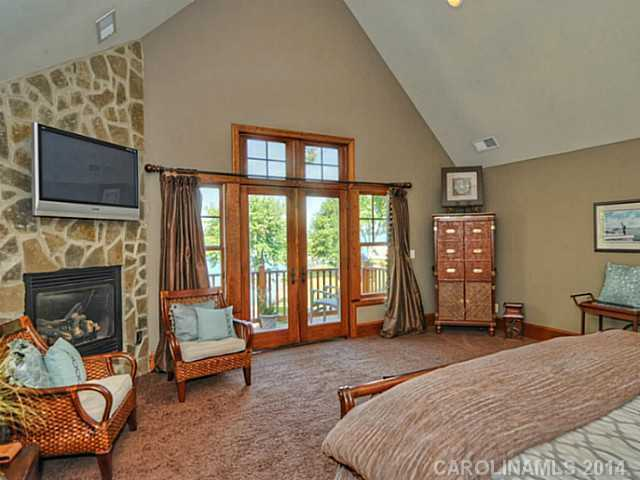 Master Bedroom Suite has a private balcony with lake views