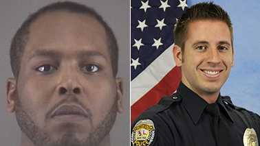 Kenneth Pinkney Jr., left, and Officer S.W. Houle, right