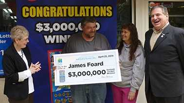 James Foard Jr., second from left, won $3 million in a North Carolina Education Lottery scratch-off game.
