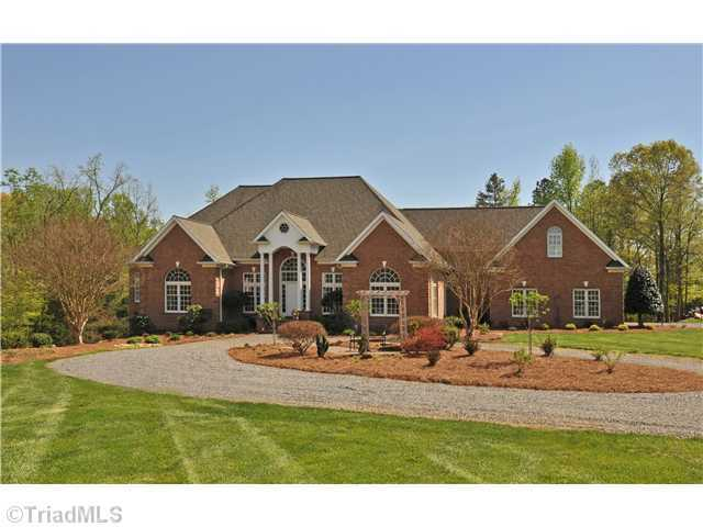 This riverfront estate is situated on almost 40 acres and borders the Yadkin River. Located in Advance, the four bedroom home is priced at $1,400,000.