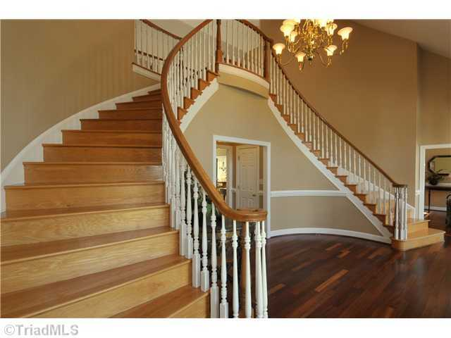 Two-story grand Foyer with dual staircase