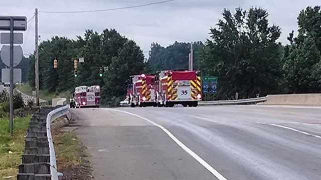Trollingwood-Hawfields Road was closed after a chemical spill near Interstate 40-85 Friday morning.