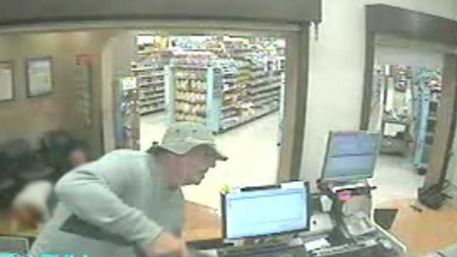 Surveillance image of Salisbury Walgreens armed robbery suspect. Victims have been blurred.