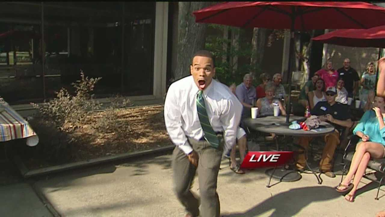 Chris Lea challenged a cheerleader to do a stunt during the WXII Backyard BBQ. Hers was flawless, but his...wasn't.