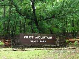 Rising to an elevation of 2421 feet, the mountain was dedicated a National Natural Landmark and now serves as a beacon to hikers, rock climbers, and nature lovers. A 6.5 mile wooded corridor trail joins the Mountain Section of the park with the Yadkin River Section.