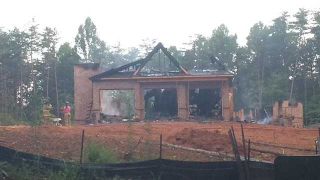 Fire heavily damaged a house under construction Flint Hill Vineyards in East Bend early Thursday.