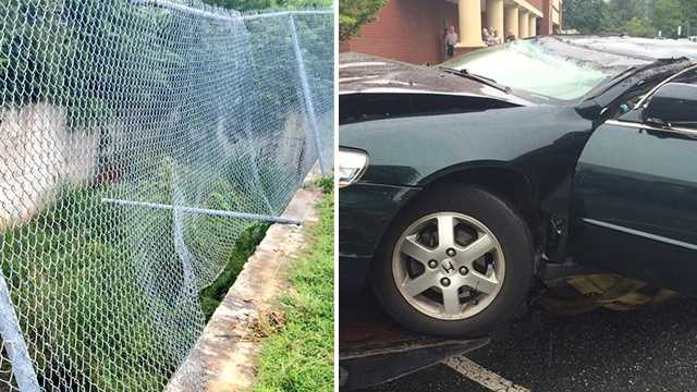 A car was pulled from a drainage area near a Winston-Salem parking lot after plowing through a fence and dropping an estimated 20 feet.