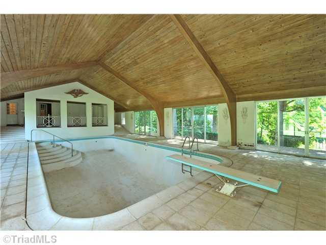 Indoor Swimming Pool with a wood ceiling
